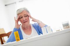 Senior woman feeling sick Stock Photos