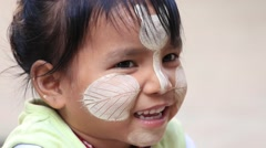 Young girl with thanaka on face in local school. Mandalay, Myanmar, Burma Stock Footage
