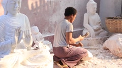 Burmese stonecutter carved marble statue Buddha in workshop, Myanmar, Burma Stock Footage