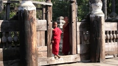 Young monk standing and looking at monastery in Mandalay. Myanmar, Burma Stock Footage