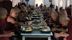 Buddhist monks eating lunch at monastery. Mandalay , Myanmar, Burma Stock Footage