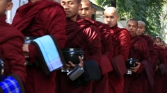 Buddhist monks procession for getting unique daily lunch in monastery, Myanmar Stock Footage