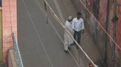 People on the narrow streets of Agra Stock Footage