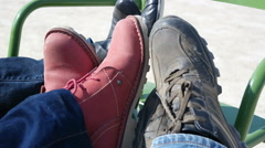 Legs on green chair. Close up on background. Stock Footage