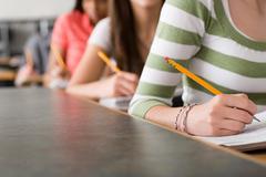 High school students writing Stock Photos