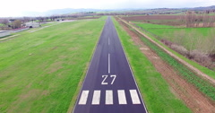 Pov of plane landing in airport on runway aerial shot Stock Footage