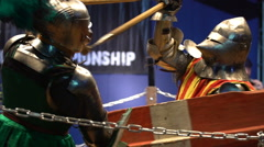 Stock Video Footage of Two medieval knight fighting in the arena with spears. Slow motion.