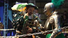 A squire helps a knight put on the shield before a fight. - stock footage