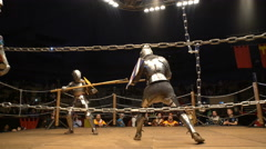 Two medieval knight fighting in the arena with spears. - stock footage