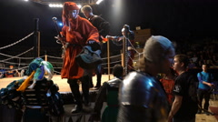 Squires, judges and knights out of the arena after a jousting tournament. Stock Footage