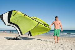 Man with kiteboard - stock photo