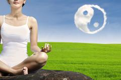 Ying yang symbol and woman exercise yoga - stock photo