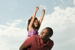 Father carrying daughter - stock photo