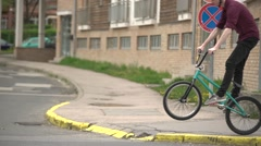 Biker jumps on the street slo-mo Stock Footage