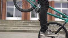 Biker front wheel no hand flatland Stock Footage