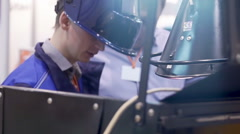 A static medium shot of a welder welding.  Nat sound is included. Stock Footage