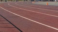 Athletics running in the stadium - stock footage