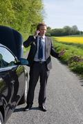 A man having automobile trouble Stock Photos