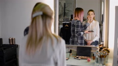 Professional make-up artists working with a brush. recognized stylist and the Stock Footage