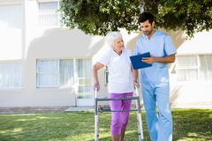 Nurse speaking with a senior woman Stock Photos