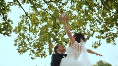 Groom lifts his bride up - stock footage