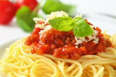 Spaghetti with meat-based tomato sauce and grated cheese - stock photo