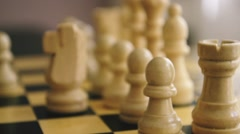 White chess pieces in close up with a changing sharpness Stock Footage