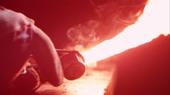 Torch being lit by sparker on anvil Stock Footage