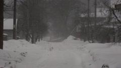 А snow storm in suburbia. - stock footage