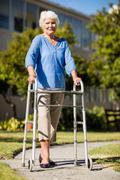 Senior woman posing with her Zimmer Frame Stock Photos