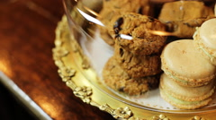 Some macaroons and cookies in a glass bell jar Stock Footage