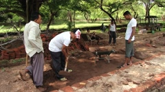 People do restoration work in the ancient city of Polonnaruwa, Sri Lanka. - stock footage