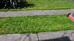 Man Mowing His Yard With Electric Lawn Mower Stock Footage