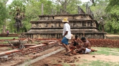 People do restoration work in the ancient city of Polonnaruwa, Sri Lanka. Stock Footage