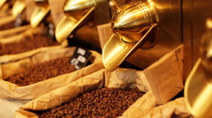 Close up of paper stand-up poucheswith coffee beansinside for sale in a local Stock Footage