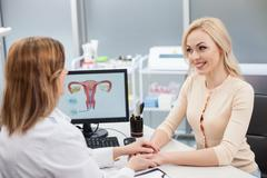Experienced general practitioner is supporting her patient Stock Photos