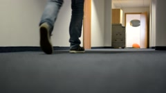 Young man go through the hall in flat - detail of legs Stock Footage