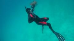 Freediver takes on action camera Cauliflower jellyfish (Cephea cephea) Stock Footage