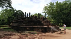 Tourist visits ruins in the ancient city of Polonnaruwa, Sri Lanka. Stock Footage