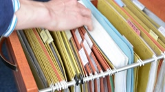 Man open the drawer and look for in folder - detail of hand Stock Footage