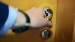 Man presses a knob of door, opens and enters to room - detail Stock Footage