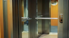 Open and close of door to elevator Stock Footage