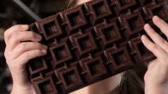 Happy young woman and huge chocolate bar Stock Footage