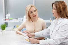 Pretty young lady is visiting general practitioner Stock Photos