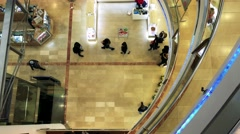 People walk and observe in shop center - aerial Arkistovideo