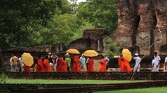 Monks pass by the ruins in Polonnaruwa, Sri Lanka. Stock Footage