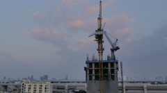 Time lapse day to night - construction with crane Stock Footage