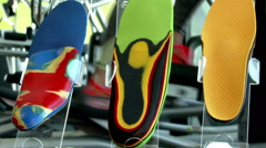 Orthopedic insoles on the background of the gym, the girl training on  walker Stock Footage