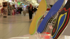 Orthopedic shoe insoles , on the background of the shopping mall with crowds Stock Footage