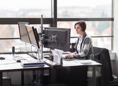 Business woman working in corporate office. - stock photo